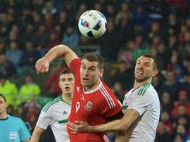 Vokes in action for Wales in a previous fixture against Northern Ireland. Twitter/FAW