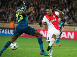 Wallace (right) kicks the ball in front of Danny Welbeck during the UEFA Champions League match at Louis II stadium in Monaco on March 17, 2015