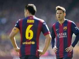 Xavi continua a encantar-se com Messi. AFP