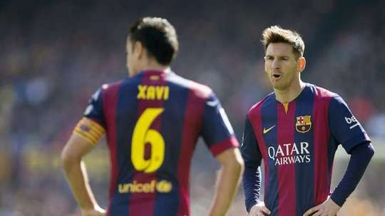 Xavi and Messi are both Bareclona legends. AFP
