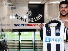 Yedlin poses with his new club's shirt. NUFC