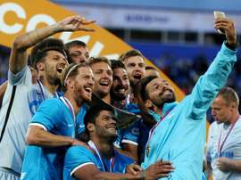 Zenit St. Petersburg players pose for a selfie with the trophy after winning their Russian Super Cup match against Lokomotiv Moscow at the Petrovsky stadium in St. Petersburg on July 12, 2015