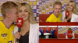 Zinchenko ruborizó a una periodista con un pasional beso en directo. Captura/SportsBoxing