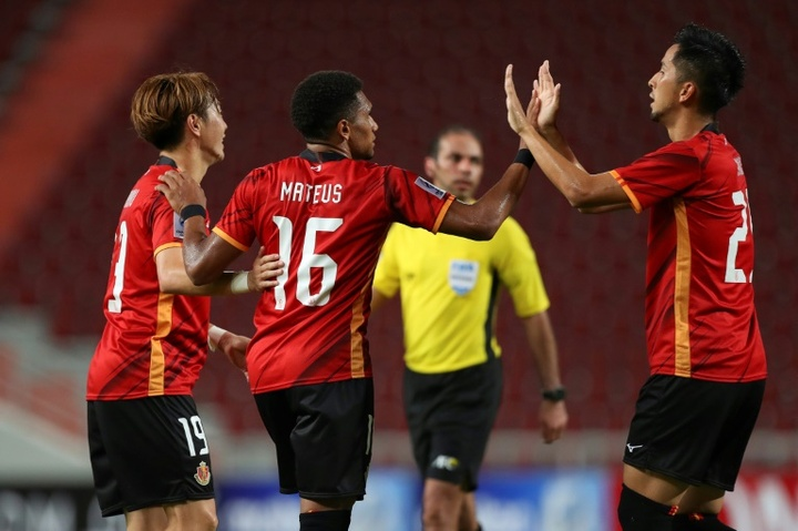 Nagoya Grampus Mateus Castro (C) celebrates after scoring against Ratchaburi. AFP