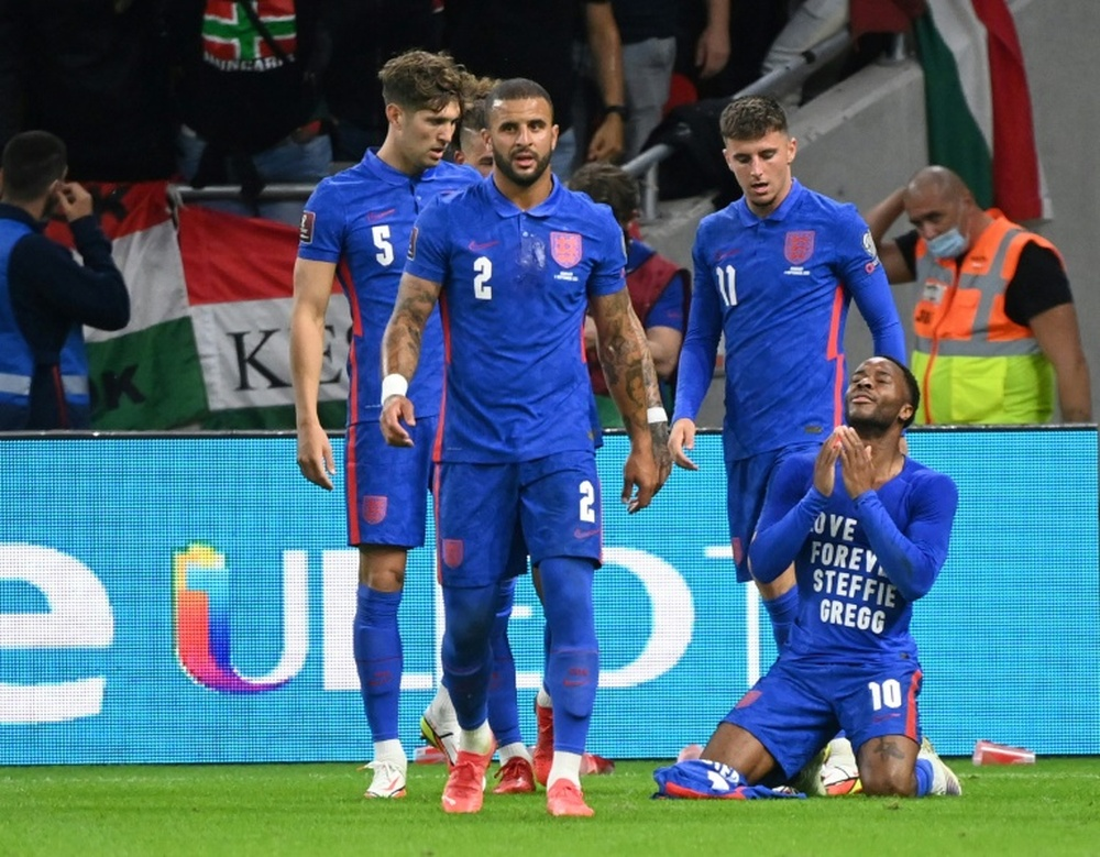 Englands forward Raheem Sterling celebrates his opening goal, with a cup thrown by Hungary fans. AFP