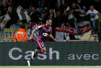 Bordeauxs French forward Thomas Toure celebrates after scoring a goal during the French L1 football match Monaco vs Bordeaux on April 1, 2016 at the Louis II Stadium in Monaco