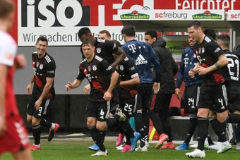 Lewandowski's record-breaking goal was met by celebrations from th eentire squad. AFP