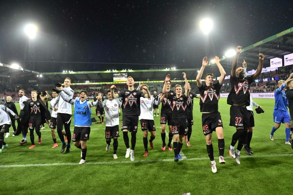 Danish delight: Midtjyllands players celebrate after defeating Celtic. AFP
