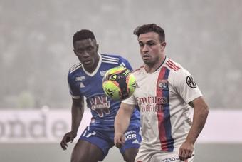 Xherdan Shaqiri (R) made his Lyon debut in the win over Strasbourg. AFP