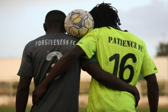 Captains of Forgiveness and Patience FC together represent new-found peace in the town of Jos. AFP