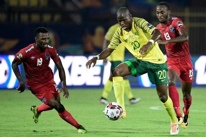 Hlompho Kekana (C) saw his spot kick saved as Mamelodi Sundowns were beaten. AFP