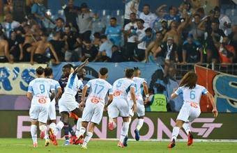 Bottles thrown, match held-up as Marseille fight back. AFP