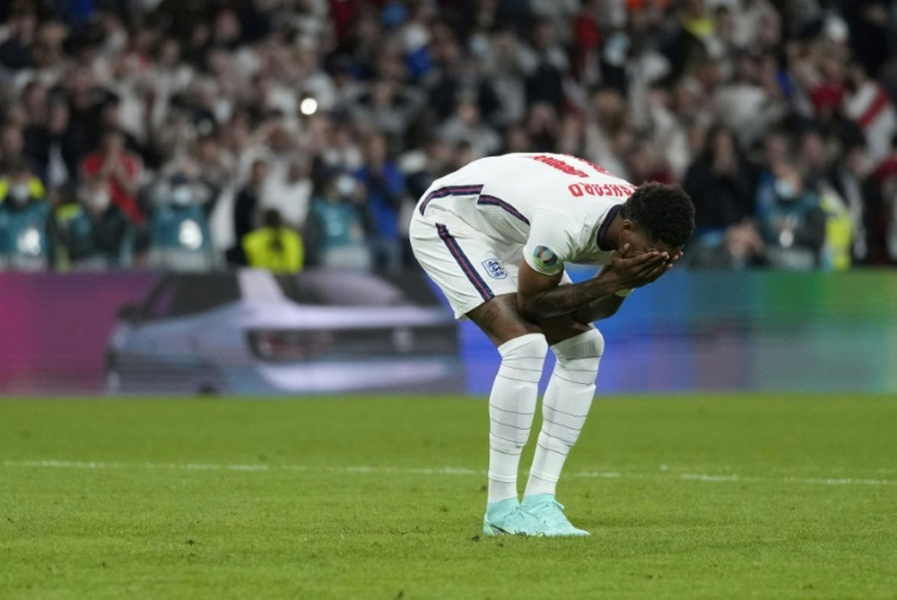 Football fan sentenced for racist message about England players. AFP