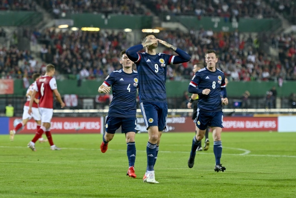 Lyndon Dykes penalty was the difference. AFP