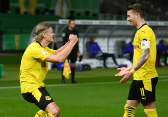 Erling Haaland (L) scored twice as Dortmund beat Leipzig 4-1. AFP