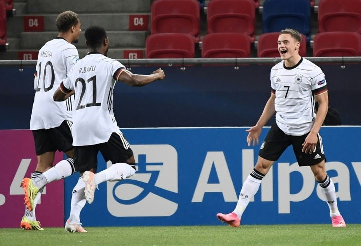 Florian Wirtz celebrates his quick-fire opener. AFP