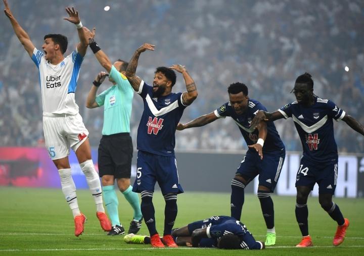 Samuel Kalu collapsed in Bordeaux's Ligue 1 opener against Marseille. AFP
