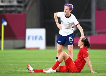 Megan Rapinoe (C) did not give anything away on her future. AFP