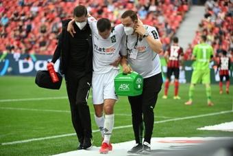 Stefan Lainer suffered a broken leg in the defeat at Bayer Leverkusen. AFP