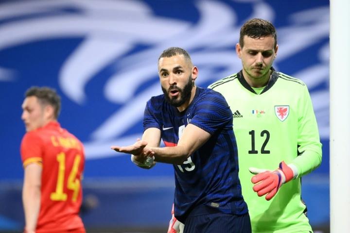 Karim Benzema was happy despite seeing penalty saved v Wales. AFP