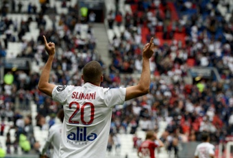 Slimani was on target for Lyon as they were held by Brest. AFP