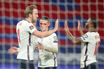 Harry Kane (L) scored as England beat Poland 2-1. AFP