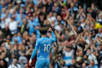 Pep Guardiola wants Jack Grealish to score more goals at Man City. AFP