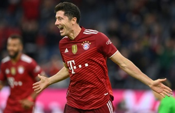 Robert Lewandowski scored three times in a 5-0 win over Hertha. AFP