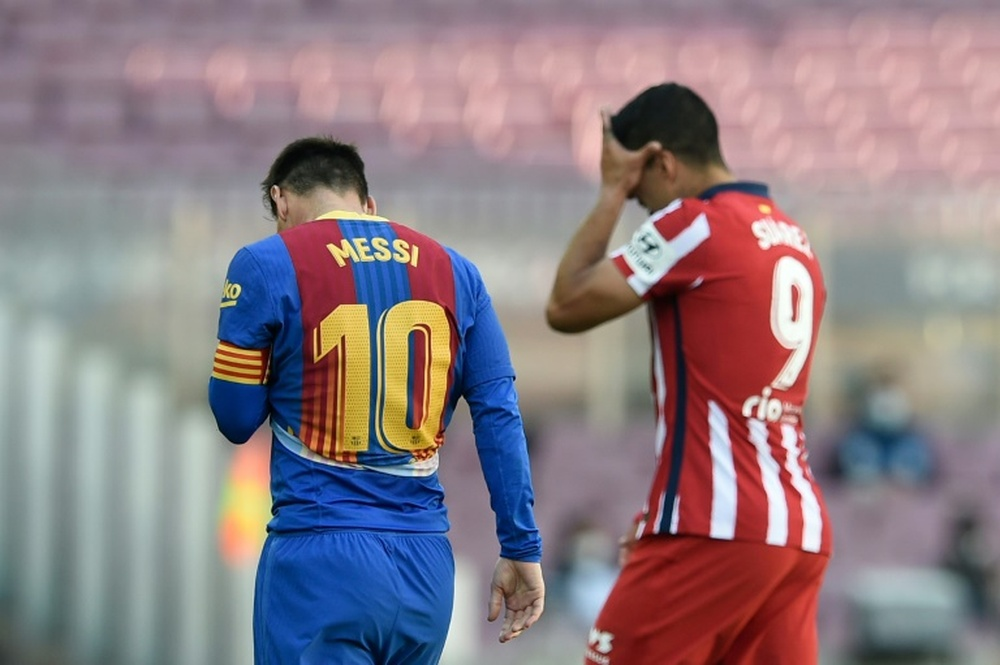 Suarez 'delighted' if Messi stays at Barcelona