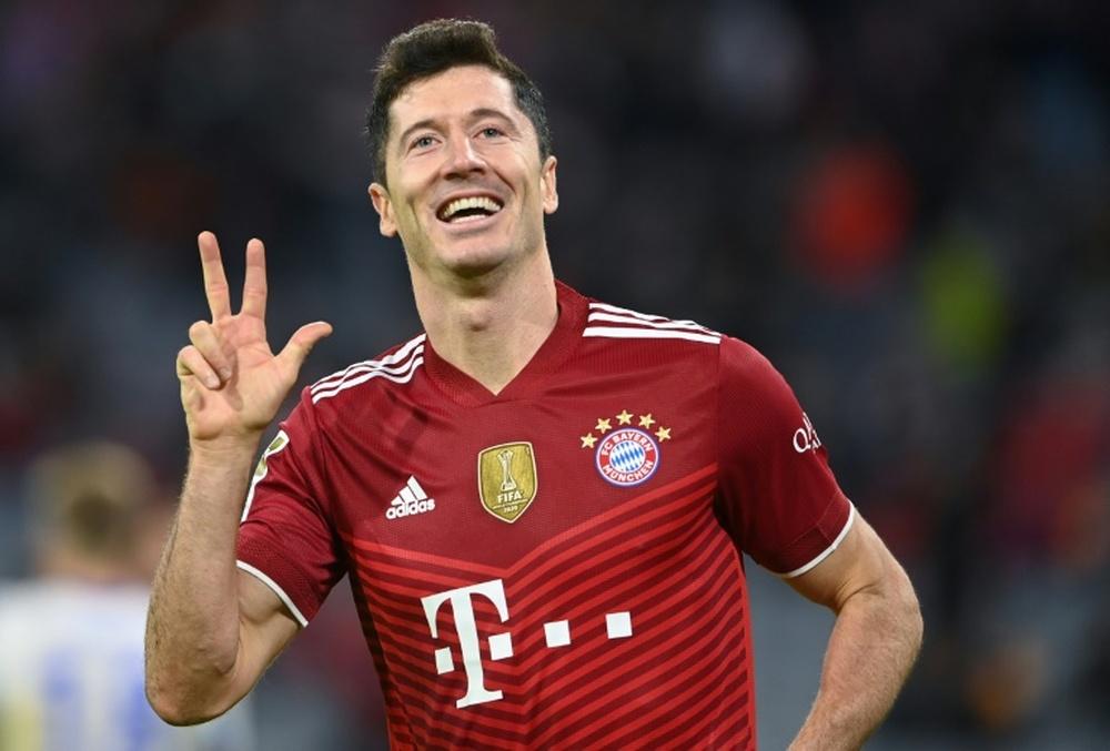 Lewandowski celebrates his hat-trick as Bayern Munich thrashed Hertha Berlin 5-0 on Saturday. AFP