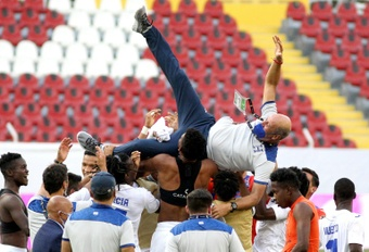 Honduras players lift coach Miguel Falero as they celebrate their passage to the Tokyo Olympics. AFP