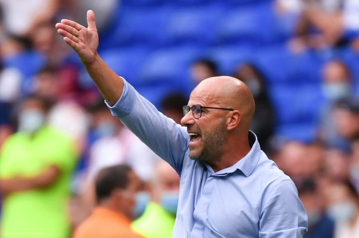 Lyon boss Peter Bosz was disappointed to lose a two goal lead. AFP