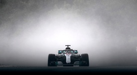 Mogyorod (Hungary).- British Formula One driver Lewis Hamilton of Mercedes AMG GP leaves a cloud of grey smoke as he speeds during the qualifying session of the Hungarian Formula One Grand Prix at the Hungaroring circuit in Mogyorod, Hungary, 28 July 2018 (reissued 21 May 2020). Considered to be a EFE/EPA/TAMAS KOVACS/Archivo